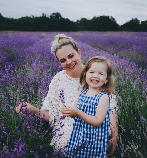 Smiling mother and daughter in lavender. Mother's day concept.